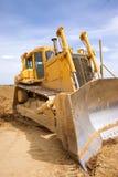 Digger. A yellow digger at work Royalty Free Stock Photos