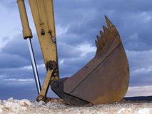 Digger. Shovel in front of a cloudy sky royalty free stock photo