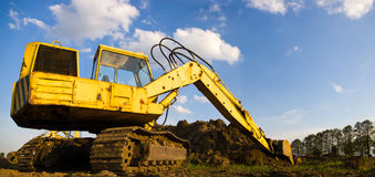 Digger. Heavy Duty construction equipment parked at work site royalty free stock photo