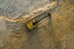 Digger. In sand quarry from an aerial view royalty free stock images