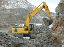 Digger in action. Digger in open cast mining quarry Stock Photo