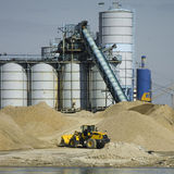 Digger in action, sand industry. Digger at the sand separation industrial site Stock Photography