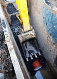 Digger arm, sewage pipe digging Royalty Free Stock Images