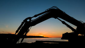 Digger Arm Sunset Stock Photo