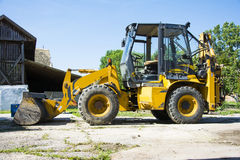 Digger in a backyard. Digger in the backyard ready for work royalty free stock photo