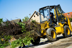 Digger in a backyard working Stock Photography