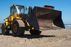 Digger at the beach Stock Photography