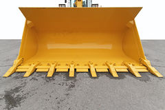 Digger bucket. Big yellow bucket scoop at digger machine stock photo