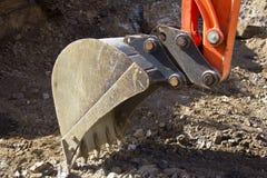 Digger. Bucket cutting away at rock Stock Photography