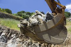 Digger bucket full of rocks Stock Photography