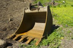Digger bucket. Laying in a construction area Royalty Free Stock Images