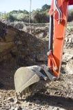 Digger bucket. Scraping away at rock substrate Stock Photography