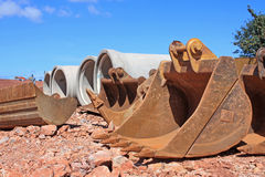 Digger buckets. And congrete pipes Stock Image