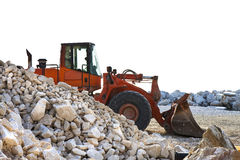 A digger builds a dam Royalty Free Stock Images