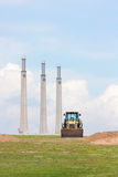 Digger and chimneys (vertical) Stock Photo