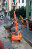 Digger on a city street Stock Photo