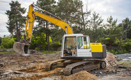Digger on construction site. Yellow digger on construction site stock photo
