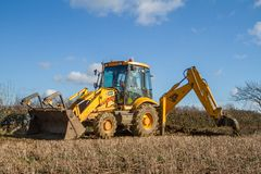 Digger in countryside clearing ditch Stock Images