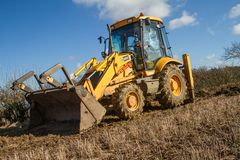 Digger in countryside clearing ditch Stock Photos