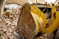 Digger demolishing a building Royalty Free Stock Photo