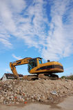 Digger after demolition Stock Images