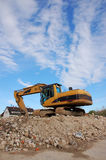 Digger after demolition Royalty Free Stock Photography