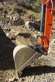 Digger. Bucket cutting away at rock Stock Photos