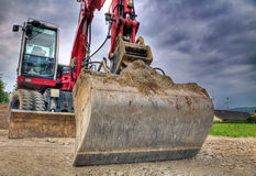 Digger in dramatic shot Royalty Free Stock Images