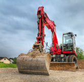 Digger in dramatic shot Stock Photography