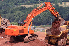 Digger and Dump Truck Royalty Free Stock Images