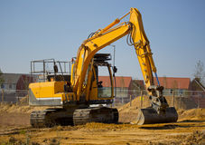 Digger 3. A digger or earth mover with caterpillar tracks on a building site stock photos