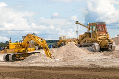 A digger`s moving soil Royalty Free Stock Photography