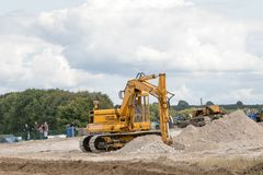 A digger`s moving soil Stock Images