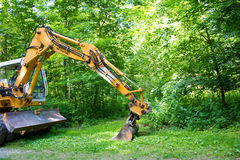 Digger in the forest. Royalty Free Stock Image
