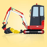 Digger with gold Royalty Free Stock Photos