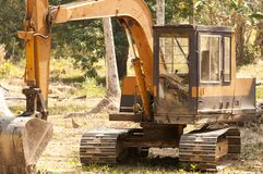 Digger in the jungle clearing trees Royalty Free Stock Photography