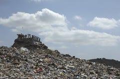 Digger At Landfill Site fotos de archivo