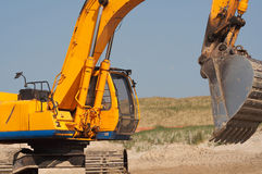 Digger landscape. Closeup shot of earth moving/digger. Landscape view stock image