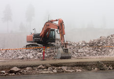 Digger in mist Stock Photo