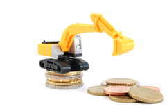 Digger an money. Making euro money coins with digger isolated on white background Stock Photo