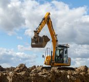 A digger moving soil Stock Photography