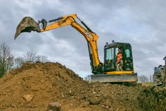 A digger moving soil Royalty Free Stock Images