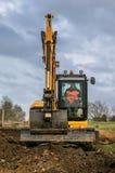 A digger moving soil Stock Photos