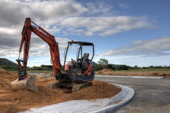 Digger. A digger in a new development area constructing road royalty free stock photography