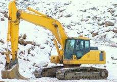 Digger in open pit. Excavator in open cast mining quarry . Winter Stock Image
