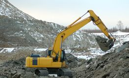 Digger in open pit Royalty Free Stock Photo