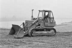 Digger operator takes a break during groundwork Stock Image