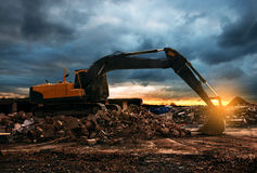 Digger. Pulls down a Building Stock Image