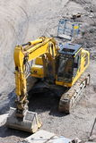 Digger in a quarry Stock Photo