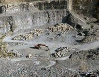Digger and quarry Stock Photos